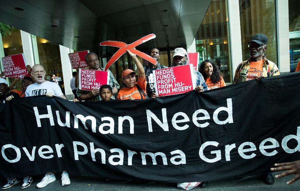 Activists rally during a protest against the price of EpiPens outside the office of hedge fund manager John Paulson, a major investor in Mylan Pharmaceuticals, in New York on August 30, 2016