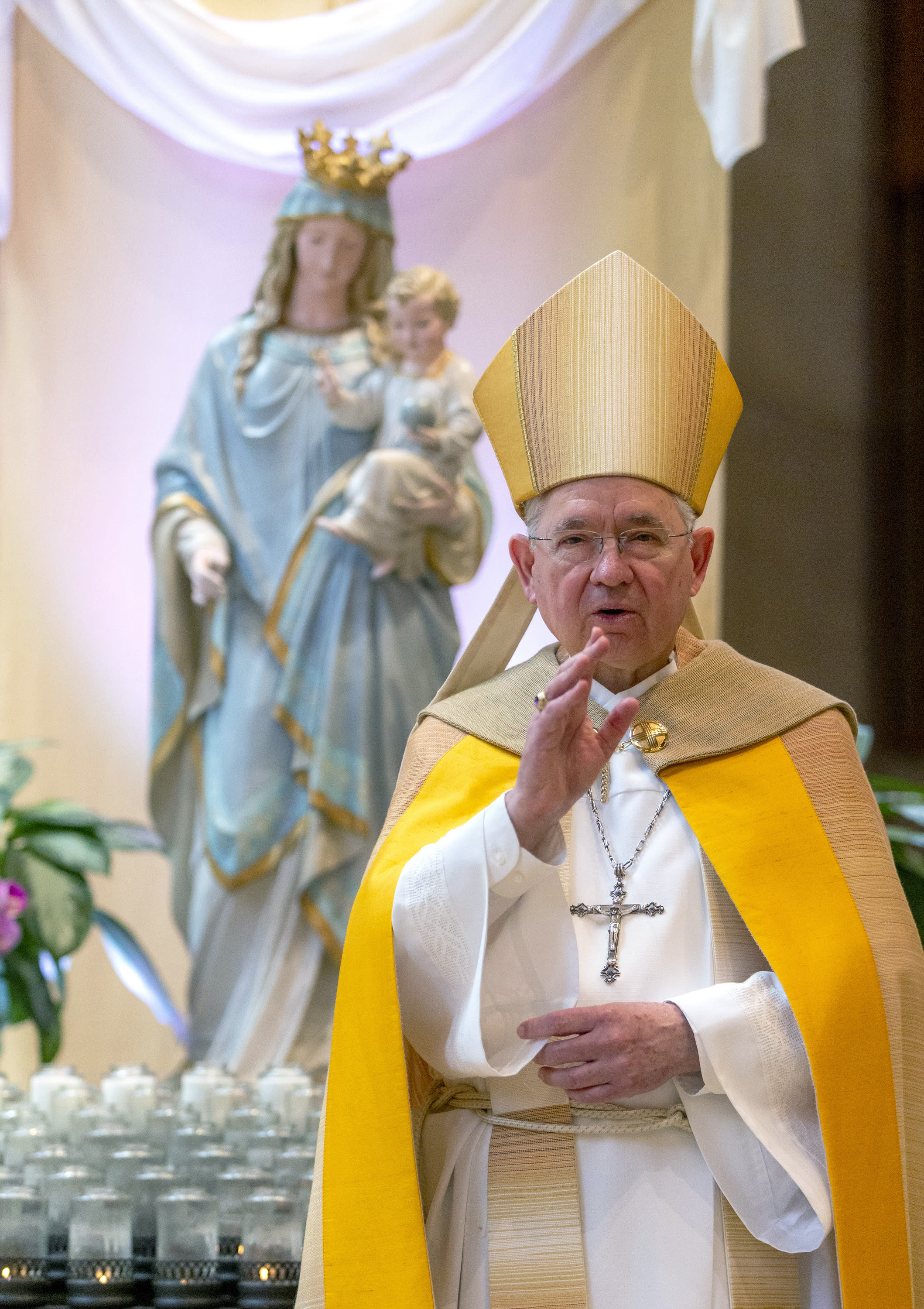 """FILE - In this Friday, May 1, 2020 file photo, Archbishop Jose H. Gomez gives a blessing after leading a brief liturgy at the Cathedral of Our Lady of the Angels in Los Angeles. Gomez heads the U.S. Conference of Catholic Bishops, which paid $20,000 to lobby the U.S. Senate and House on """"eligibility for non-profits"""" in a landmark coronavirus relief law. (AP Photo/Damian Dovarganes, Pool)"""