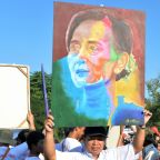 Thousands in Myanmar rally behind Suu Kyi ahead of Hague court date
