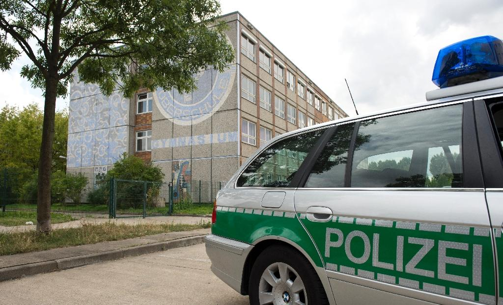 A German police officer has been accused of bragging about brutal assaults on two refugees in text messages and photos he sent to his colleagues in the western city of Hanover