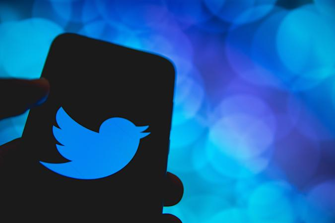 In this photo illustration Twitter logo is displayed on a smartphone screen in Athens, Greece on April 14, 2021. (Photo by Nikolas Kokovlis/NurPhoto via Getty Images)