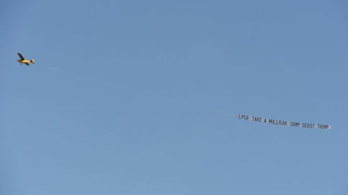 From March: A plane protests the USGA's decision to hold the Women's Open at a Trump course. (Getty)