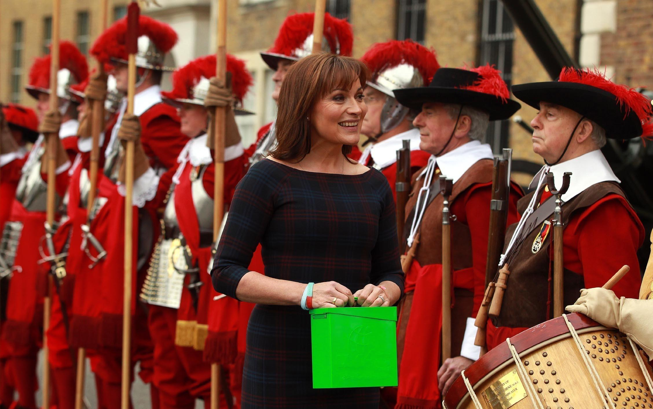 Lorraine Kelly launches the 2013 Christmas Box campaign for the military charity uk4u and then leads a 15-strong colourful Company of Pikemen & Musketeers, complete with Drumbeater and a Fifer from Bunhill Row to Armoury House, home to the Hounourable Artillery Company.