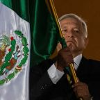 Mexico leader defends security plan as families mourn slain cops