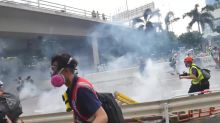 Hong Kong police baton-charge protesters In Ngau Tau Kok district during latest protests