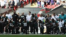 Ravens and Jaguars players kneel, lock arms together for anthem at London game