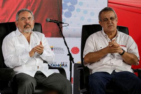 FILE PHOTO: Venezuela's Oil Minister Nelson Martinez (L) and Eulogio del Pino, president of Venezuelan state oil company PDVSA, attend the swear in ceremony of the new board of directors of Venezuelan state oil company PDVSA in Caracas, Venezuela January 31, 2017. REUTERS/Marco Bello/File Photo