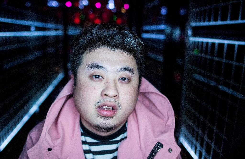 Mr Trouble's raps touch on romance, his beloved parents, and his Shanghai childhood (AFP Photo/Johannes EISELE)