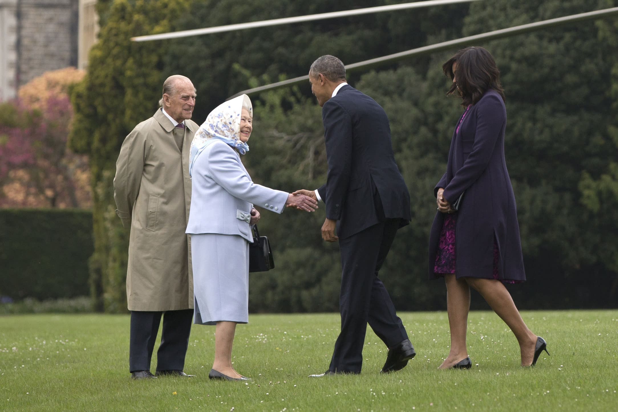 FILE - In this April 22, 2016 file photo President Barack Obama and first lady Michelle Obama are greeted by Queen Elizabeth II and Prince Philip as they arrive on Marine One at Windsor Castle in Windsor, England. With his departure from Berlin on Friday, Nov. 18, 2016 Obama will leave Europe for the last time as U.S. President. (AP Photo/Carolyn Kaster, file)