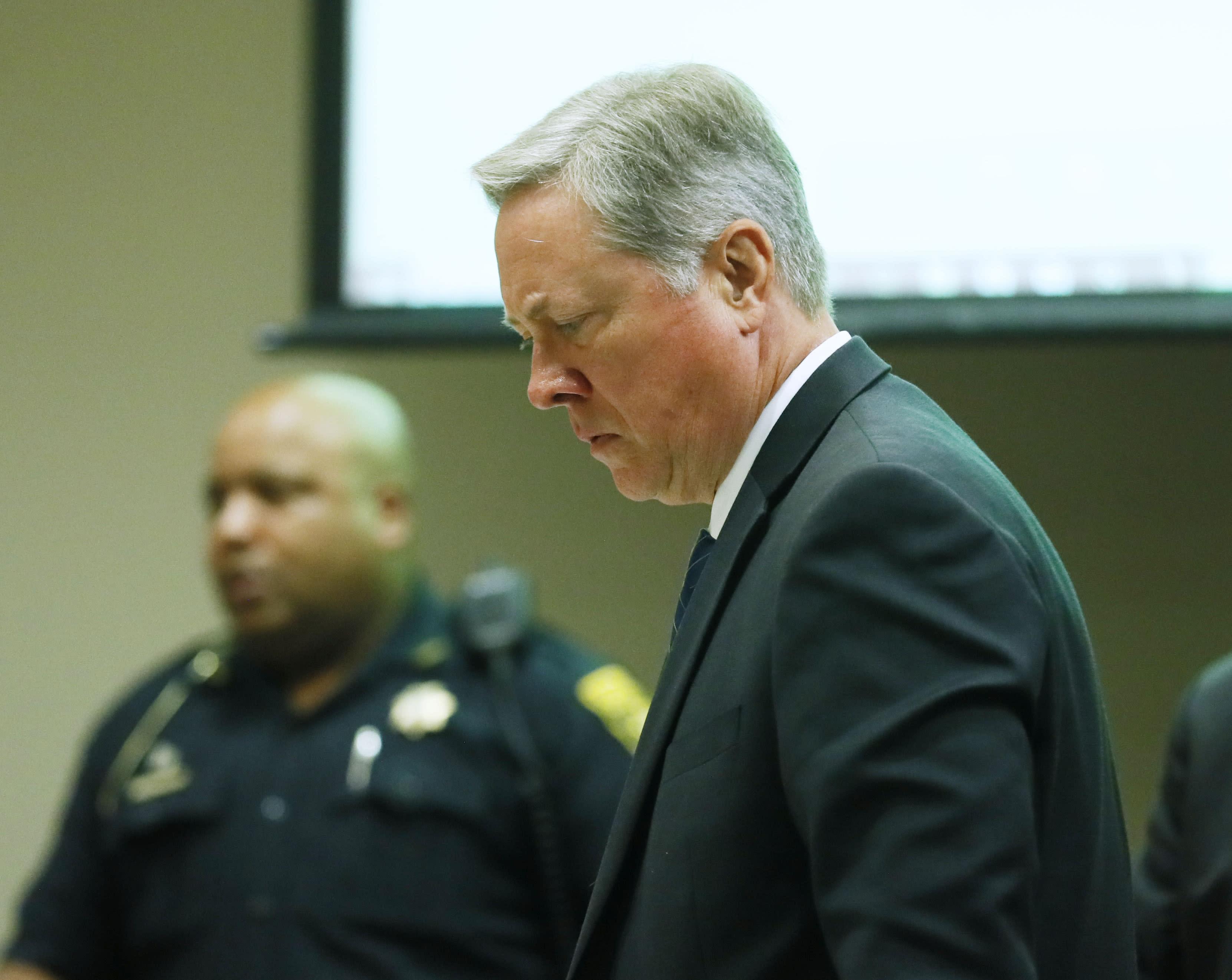 Georgia officer who fatally shot naked black man pleads
