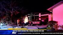Oceanside house catches fire, woman escapes with dog
