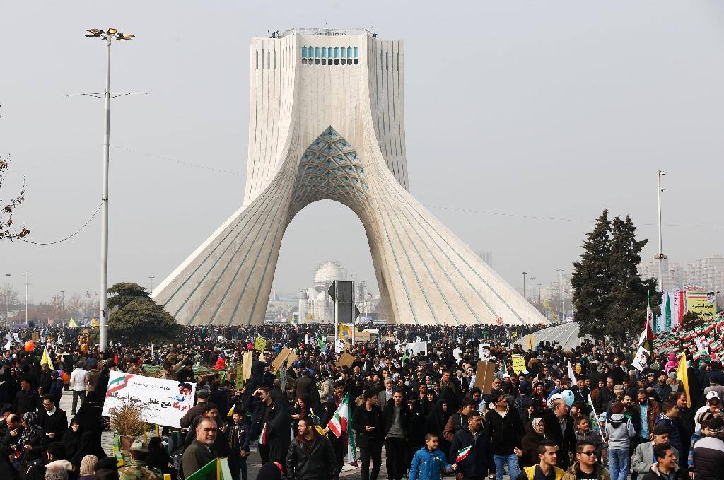Iranians take part in a rally in the capital Tehran on February 10, 2017 marking the anniversary of the 1979 Islamic revolution (AFP Photo/Atta KENARE)