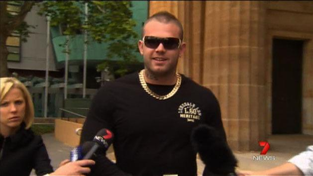 Bikie admits to gun offences
