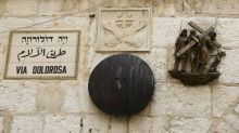 On an empty Via Dolorosa before Easter, praying for the world's sick