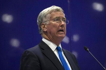 Britain's Secretary of Defence Michael Fallon delivers a speech at the Defence and Security Equipment International trade show in London, Britain
