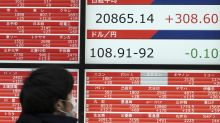 World shares mostly higher after Fed signal on rates