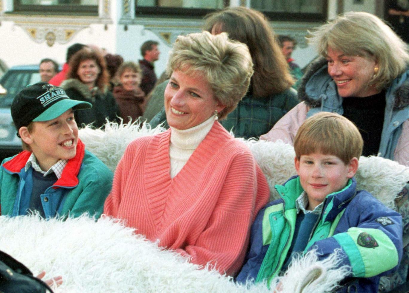Diana beams as she sits with William and Harry.