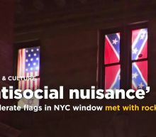 Confederate flags in NYC window met with rocks, suit, tarp