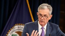 The Latest: Markets cautious ahead of Fed rate decision