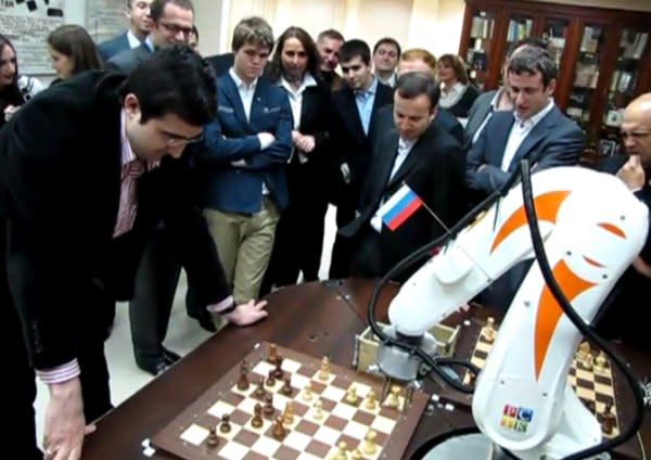 Former World Champion Vladimir Kramnik faces off against a robotic arm in a game of blitz chess