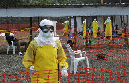 MSF health workers prepare at ELWA's isolation camp during the visit of Senior U.N. System Coordinator for Ebola David Nabarro, at the camp in Monrovia