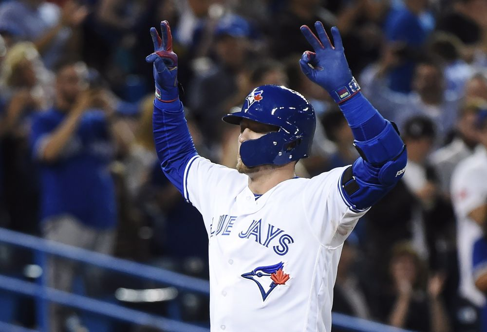 Josh Donaldson celebrates his huge homer to the fifth deck at Rogers Centre. (AP)