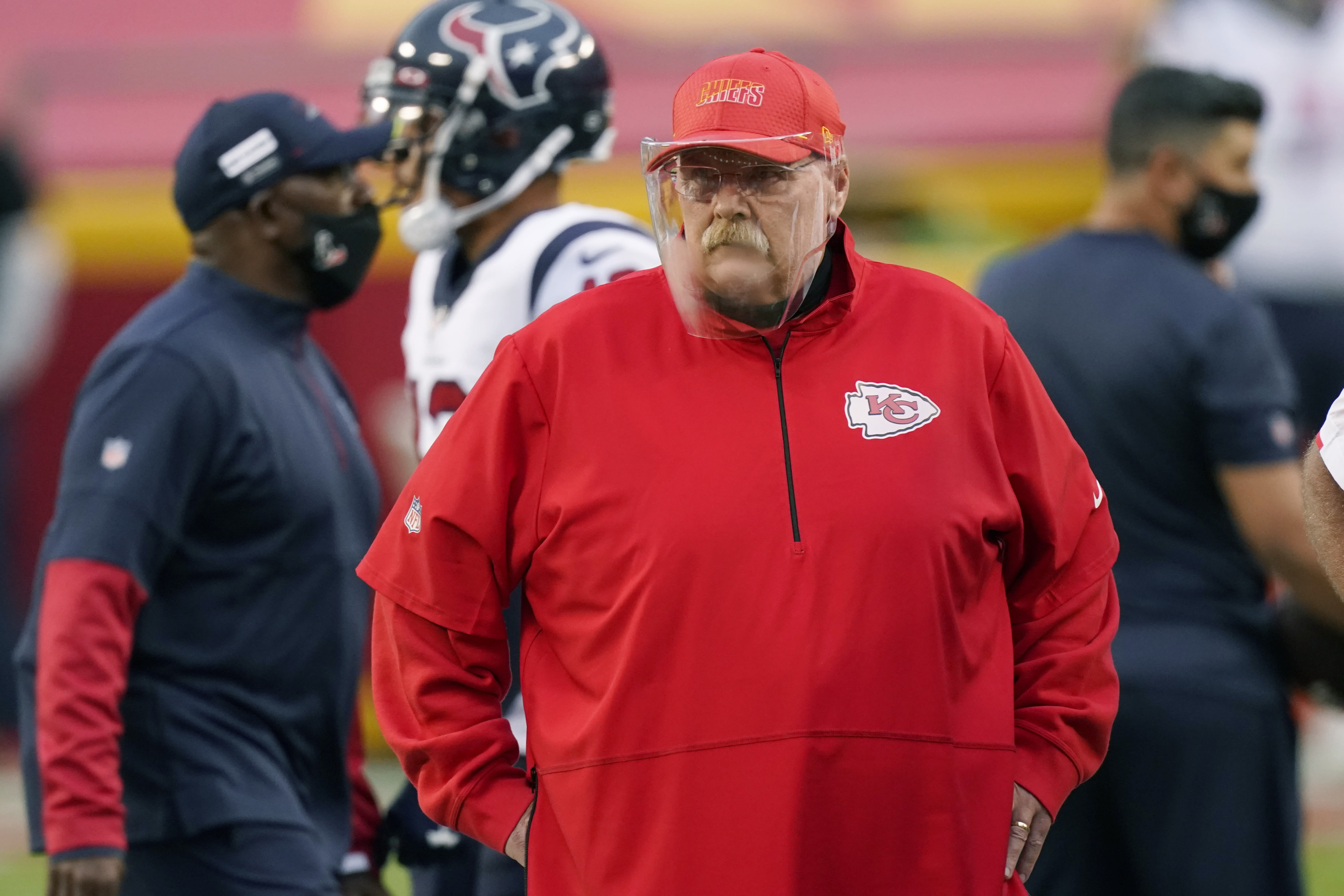 FILE - In this Sept. 10, 2020 file photo, Kansas City Chiefs head coach Andy Reid watches as players warm up before an NFL football game against the Houston Texans in Kansas City, Mo. Buffalo Bills coach Sean McDermott pays credit to experiences and advice he gained working under Reid, while the two were in Philadelphia, including getting fired by Reid in 2010, which McDermott says was the best thing to happen to his career. (AP Photo/Charlie Riedel, File)