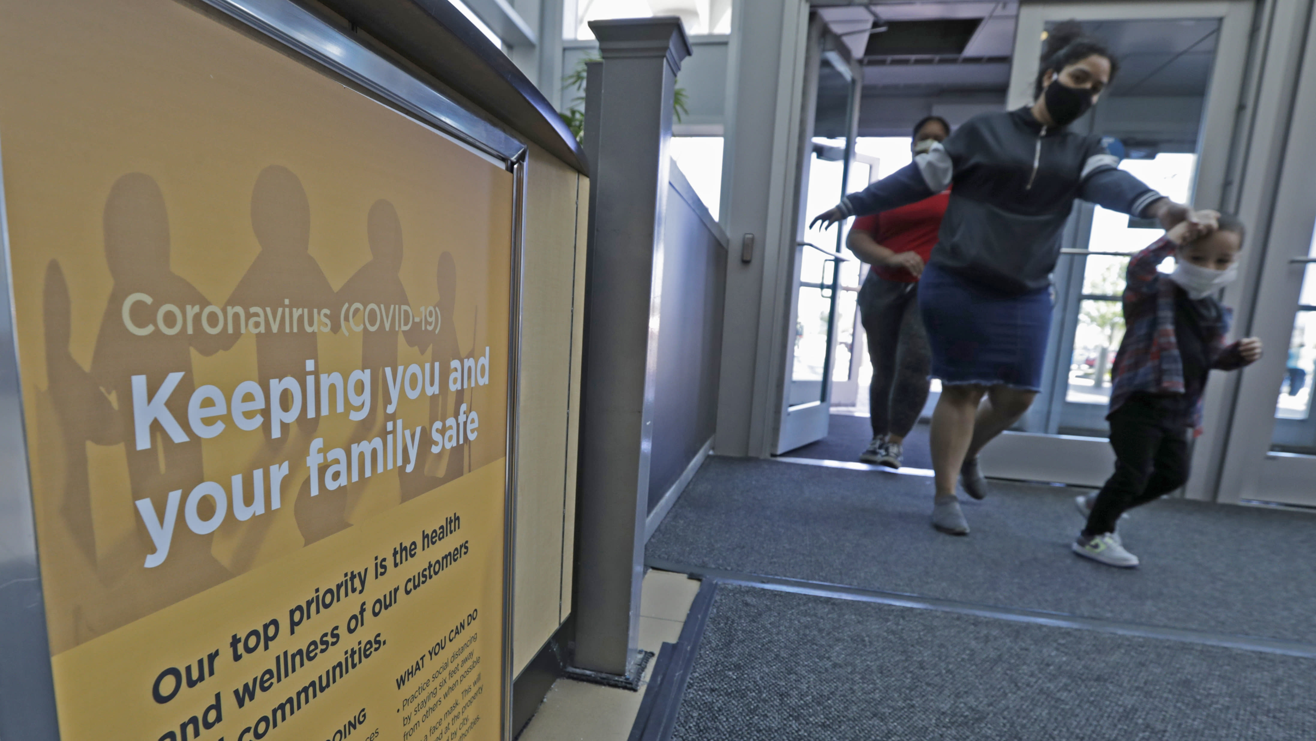 A sign on how to keep your family safe during the coronavirus pandemic rests near an entrance to SouthPark Mall, Wednesday, May 13, 2020, in Strongsville, Ohio. Ohio retail businesses reopened Tuesday following a nearly two-month-long shutdown ordered by Gov. Mike DeWine to limit the spread of the coronavirus. (AP Photo/Tony Dejak)