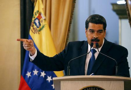 Venezuela's President Nicolas Maduro gestures during a news conference at Miraflores Palace in Caracas, Venezuela, February 8, 2019. REUTERS/Andres Martinez Casares/Files