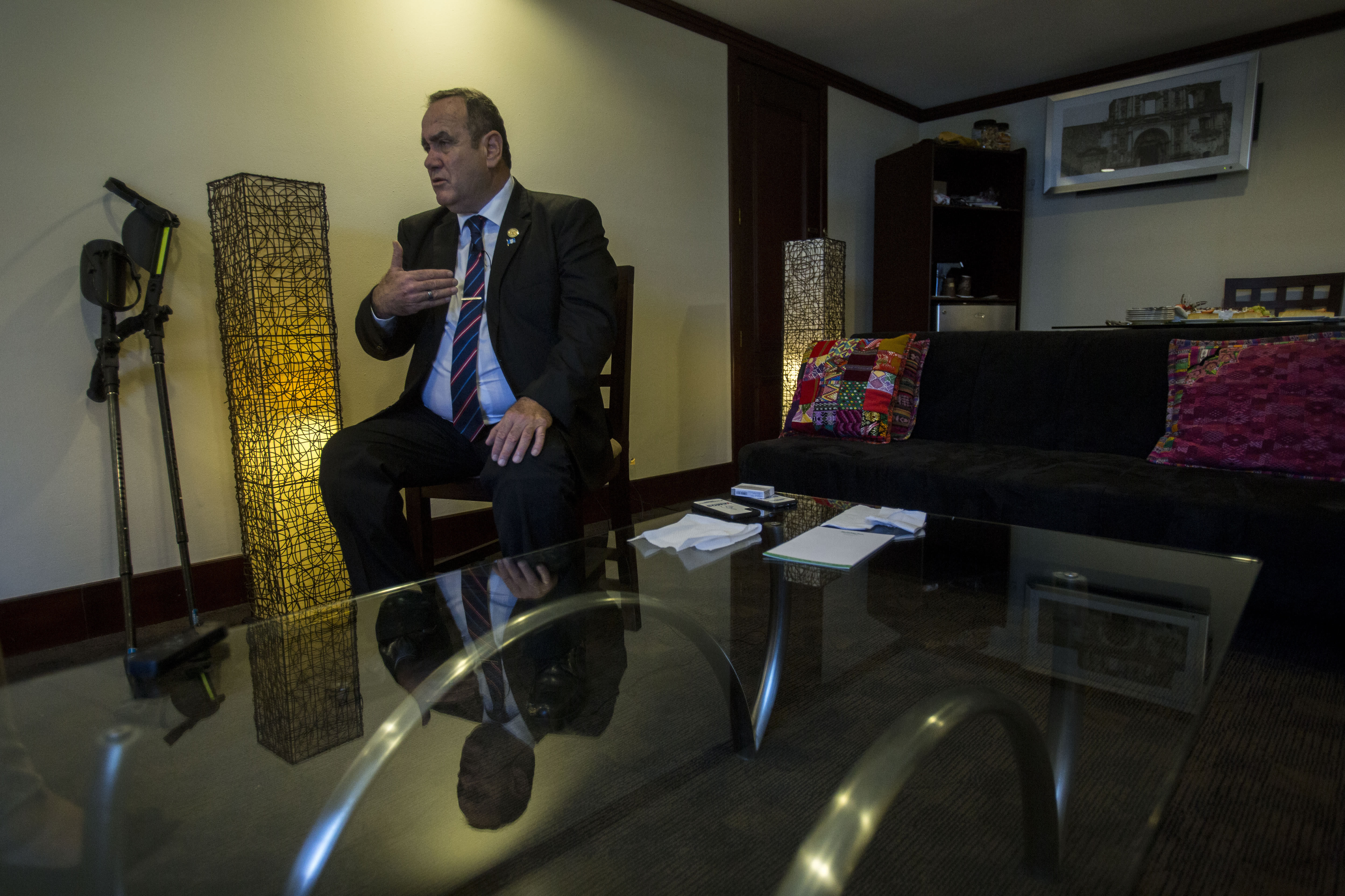"""Guatemala's President-elect Alejandro Giammattei gives an interview in Guatemala City, Tuesday, Aug. 13, 2019. Giammattei said Tuesday that his country isn't able to hold up its side of an immigration agreement with the United States or serve as a """"safe third country"""" for asylum seekers. (AP Photo/Oliver de Ros)"""