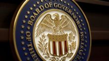 Fed holds rates steady, sees portfolio cuts 'relatively soon'