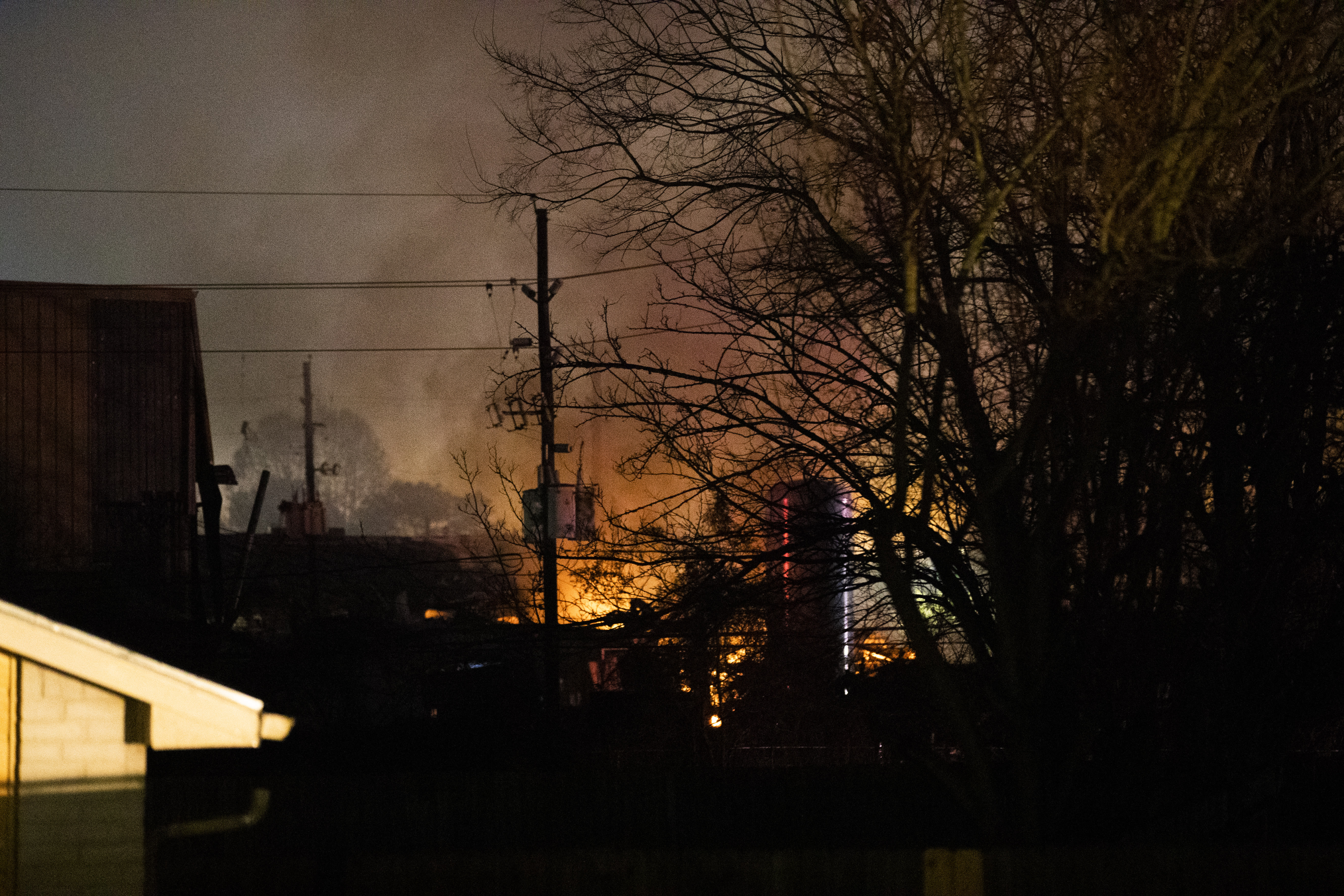 Flames fill the sky after a massive explosion rocks west Houston Friday, Jan. 24, 2020, in Houston. A massive explosion early Friday leveled a warehouse in Houston and damaged nearby buildings and homes, rousing frightened people from their sleep miles away. (Marie D. De Jesús/Houston Chronicle via AP)