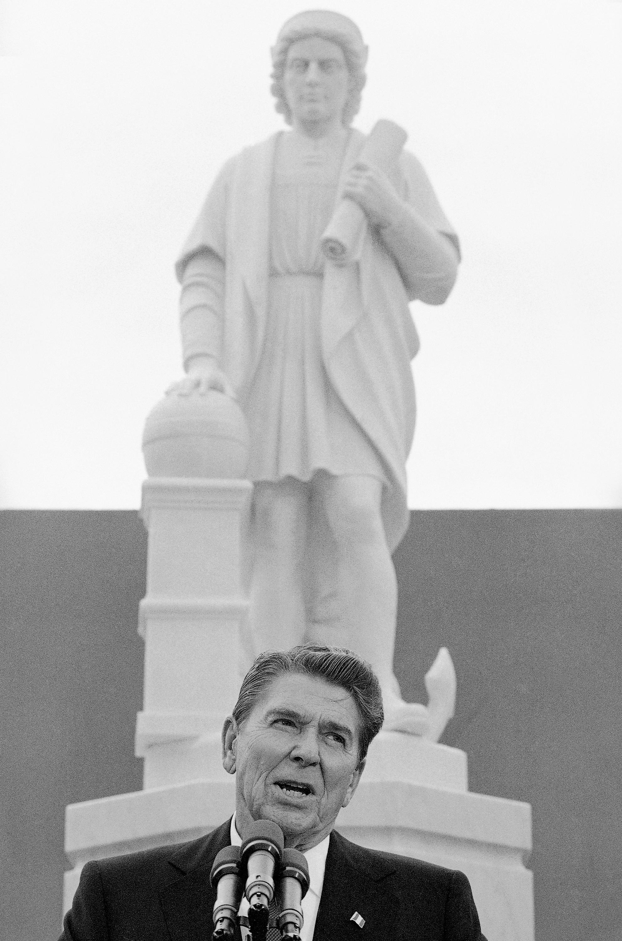 FILE - In this Monday, Oct. 9, 1984, file photo, President Ronald Reagan addresses a ceremony in Baltimore, to unveil a statue of Christopher Columbus. Pieces of the Christopher Columbus statue were retrieved from Baltimore's Inner Harbor on Monday, July 6, 2020. WJZ-TV reports the recovery comes two days after protesters pulled down the figure from the Little Italy neighborhood and threw it into the harbor.(AP Photo/Lana Harris, File)