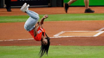 Simone Biles adds flair to ceremonial pitch