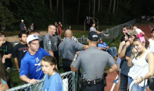Covington police officers escort a referee off the field at St. Paul's School — WWLTV
