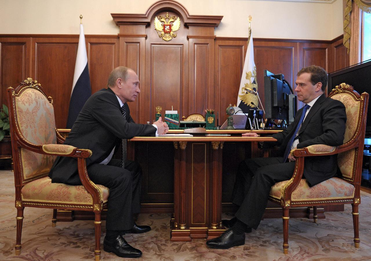 Russian President Vladimir Putin, left, speaks to Russian Prime Minister Dmitry Medvedev during their meeting in Moscow, Russia, on Monday, May 21, 2012. Putin has announced a new Cabinet, warning that it will have to fulfill its duties in a difficult global economic climate. Putin, who won a third term in March's election, said Monday that the new Cabinet, led by Prime Minister Dmitry Medvedev, should continue the course set in previous years. (AP Photo/RIA Novosti, Alexei Druzhinin, Government Press Service)