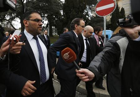 Members of Syrian opposition delegation al-Abdah and al Bahra speak to journalists as they arrive for first meeting face-to-face with Syrian government delegation and U.N.-Arab League envoy for Syria Brahimi in Geneva