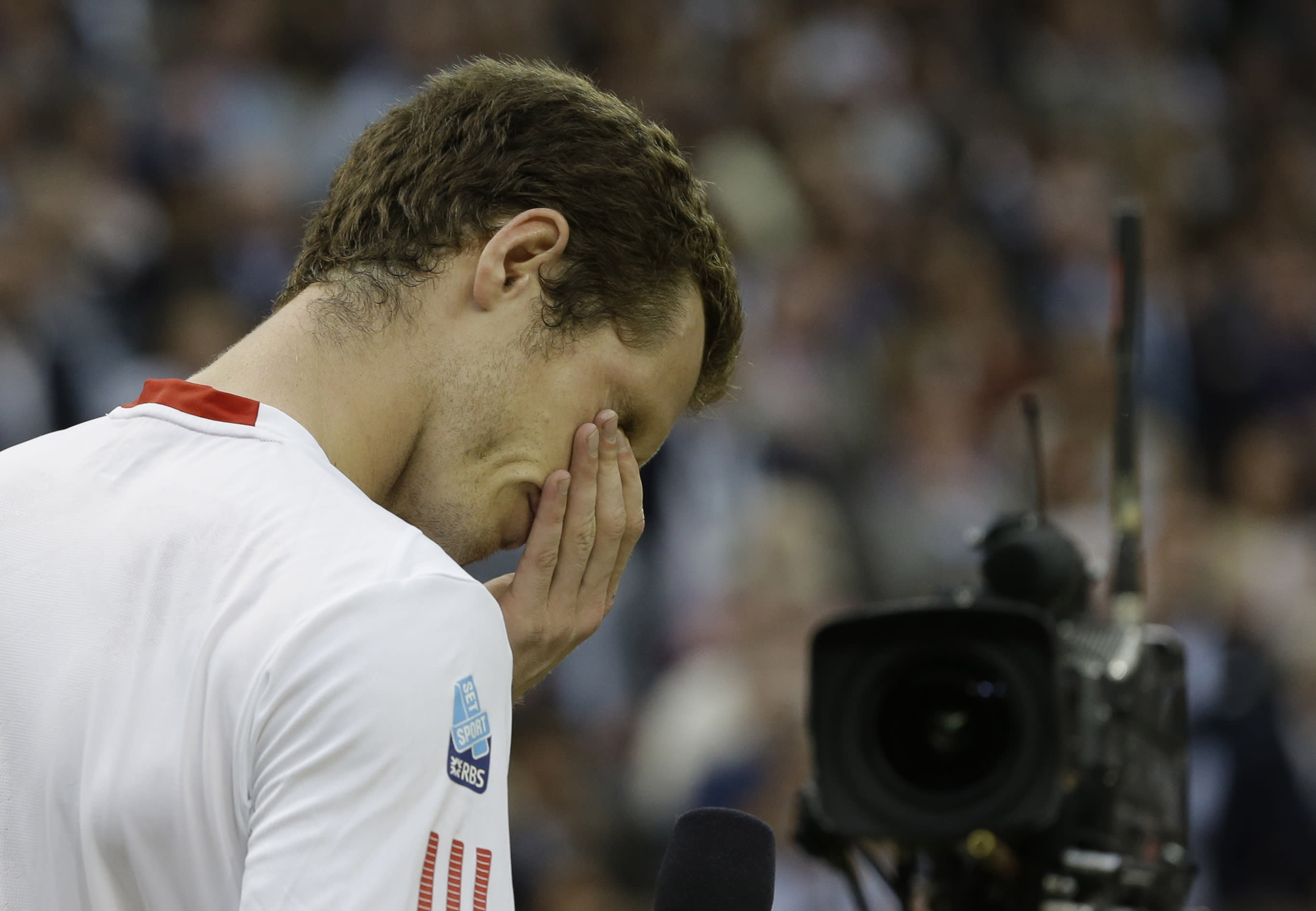 Andy Murray of Britain reacts as he speaks to spectators after his defeat to Roger Federer of Switzerland in the men's singles final match at the All England Lawn Tennis Championships at Wimbledon, England, Sunday, July 8, 2012. (AP Photo/Kirsty Wigglesworth)