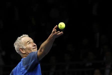 McEnroe of the U.S. serves the ball to compatriot Lendl during their BNP Paribas Showdown friendly match in Hong Kong