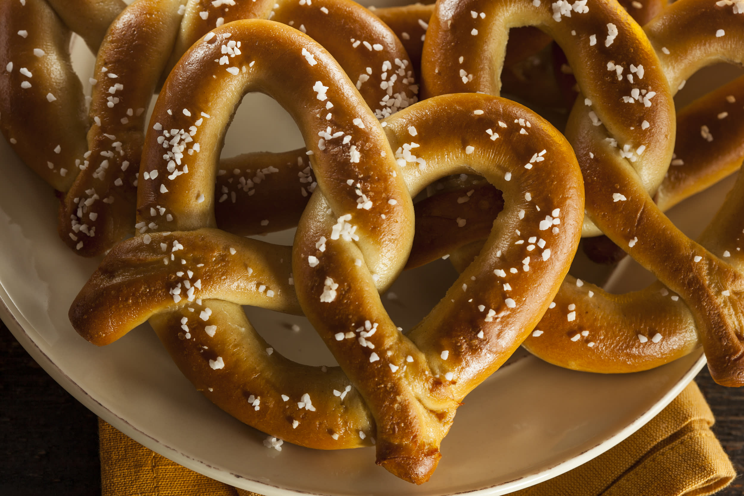 """<p><strong>Soft pretzels</strong></p>  <p>""""A big old soft pretzel is not a meal,"""" says registered dietitian Marjorie Nolan Cohn, owner of MNC Nutrition in Philadelphia. Those fluffy carbs might smell enticing, but carbo-loading before a long flight will leave your tummy rumbling again by takeoff. Look for something with protein and fiber that will keep you satisfied until you land, or better yet, pack a meal from home. Nolan Cohn recommends making a sandwich at home to save money or packing leftovers like pasta salad or grilled chicken in an old, washed plastic container, such as a cottage cheese tub.</p>  <p>(Getty)</p>"""