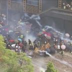 Students clash with police as violence erupts in Hong Kong