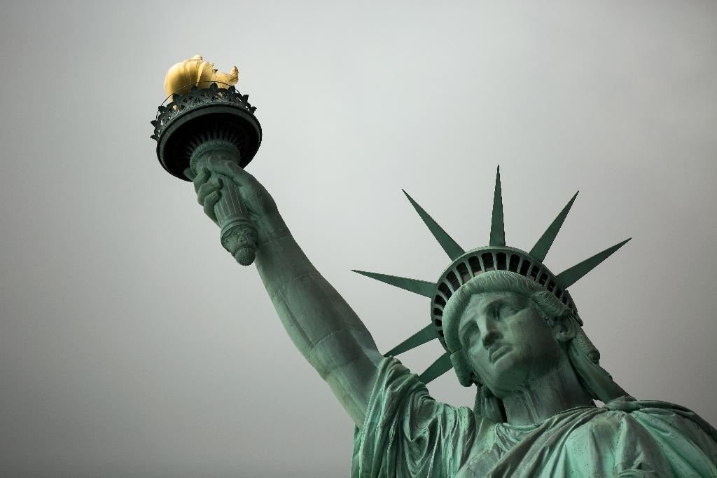 The Statue of Liberty in New York has been a welcoming symbol to new immigrants for more than a century, even as US history has been pockmarked with immigration backlashes (AFP Photo/Drew Angerer)