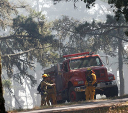 Crews battle to quell California wildfire near Big Sur coast