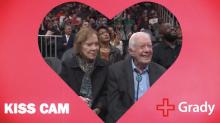 Former president Jimmy Carter, 94, smooches 91-year-old wife Rosalynn on the kiss cam
