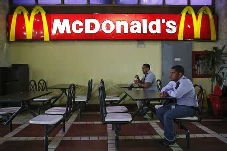 People dine at McDonald's in Caracas January 6, 2015. REUTERS/Carlos Garcia Rawlins
