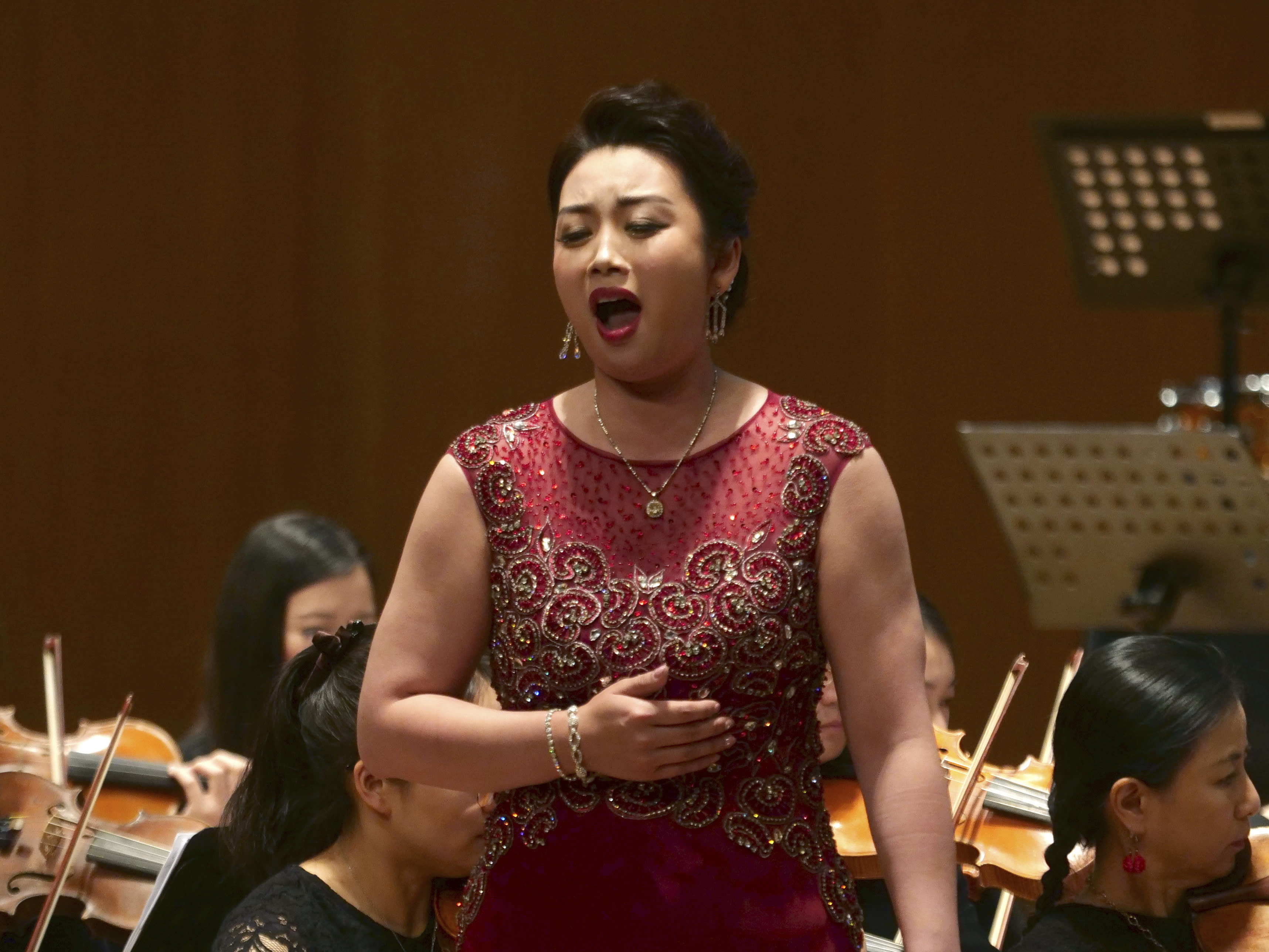 North Korean soprano singer Kim Song Mi performs at the Shanghai Oriental Arts Center in Shanghai on Sunday, May 12, 2019. South Korean Violinist Won Hyung Joon and his North Korean soprano partner, Kim perform in a rare joint performance they hope would help bring the divided Koreas closer together via music. Their performance comes three days after North Korea fired two suspected short-range missiles in the second such weapons test in five days.(AP Photo/Dake Kang)