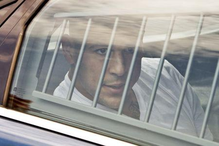 New England Patriots tight end Hernandez is led out of the North Attleborough police station after being arrested