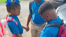 Photo of children praying before their first day of school goes viral