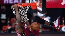 Booker's 35 points lead surprising Suns past Heat 119-112