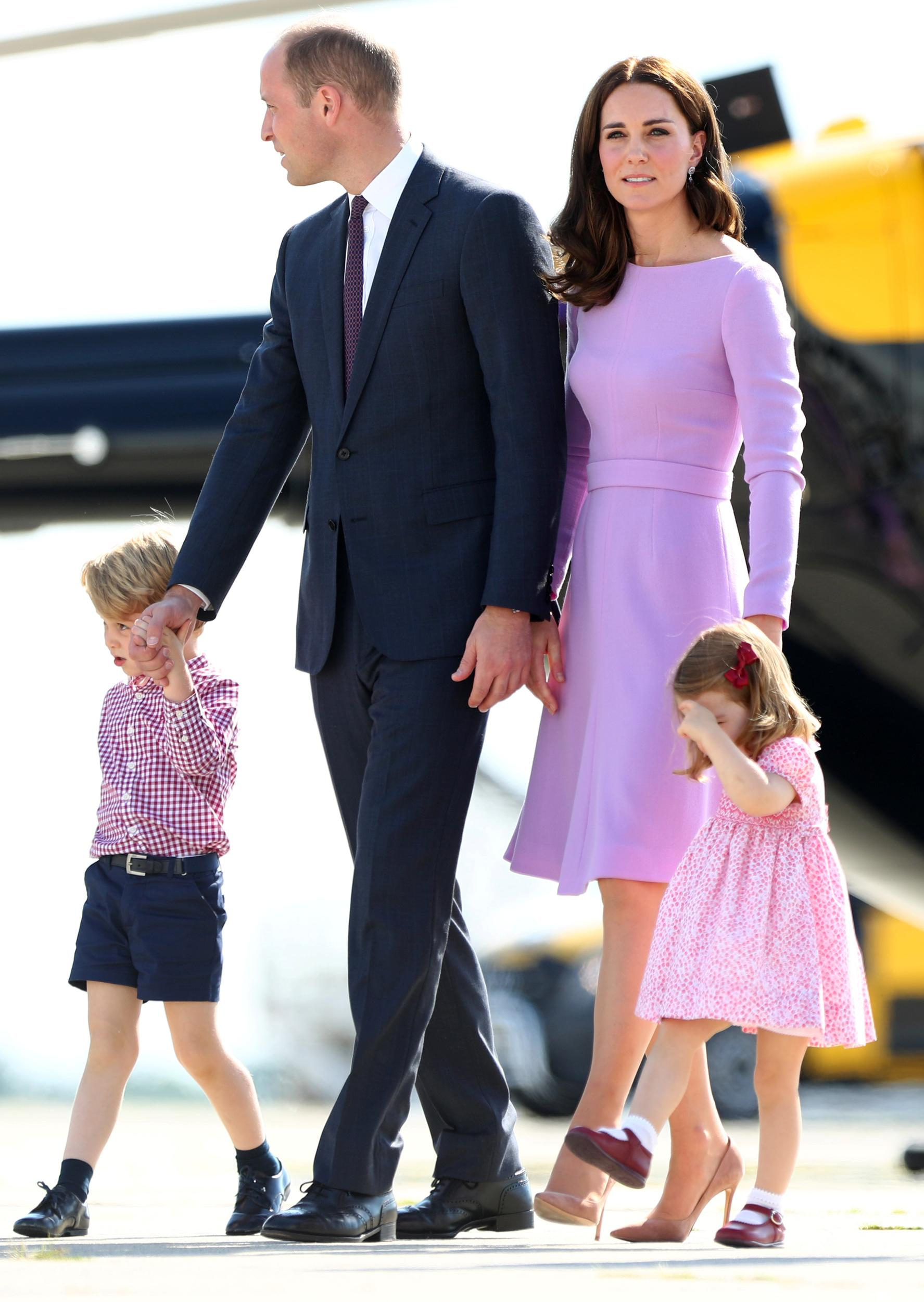 Britain's Prince William, the Duke of Cambridge, his wife Princess Kate, the Duchess of Cambridge, Prince George and Princess Charlotte walk past helicopters at the airfield in Hamburg Finkenwerder, Germany, July 21, 2017.    REUTERS/Christian Charisius/POOL